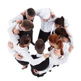 Waiters and waitresses standing in circle. Isolated on white Royalty Free Stock Photos