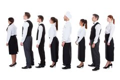 Waiters and waitresses standing in queue Royalty Free Stock Photos
