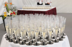 Waiters welcome visitors. Tables with drinks are covered in a years tent Royalty Free Stock Images