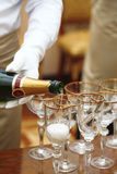 Waiters in white gloves poured champagne Royalty Free Stock Images