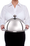 Waitess serving a silver dome or cloche Stock Image