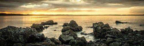 Rocky beach hihi beach new zealand travel sunset royalty free stock photo