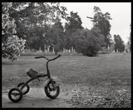 Waiting. Tri-cycle, art, black and white, background, narative, childhood, scenic, landscape, home town Stock Images