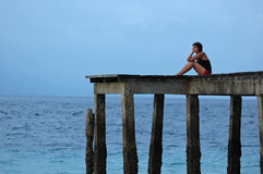 Waiting... Girl waiting on an old pier Stock Photography