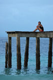 Waiting... Girl waiting on an old pier Royalty Free Stock Image