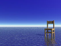 Waiting. Chair in the water and blue sky Stock Photos