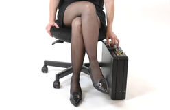 Waiting. Young woman with mini-skirt, boots and suitcase Stock Photos