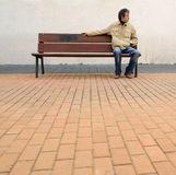 Waiting. A man waiting on a bench Royalty Free Stock Photo