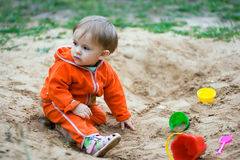 Waiting. One year old child in a sand-box is waiting for mother Royalty Free Stock Photography