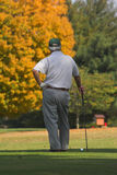 Waiting. Golfer waiting for other players to move on so he can drive his next ball Royalty Free Stock Photography