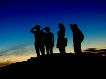 Waiting. Few friends waiting and looking to the distance on the top of the cliff Stock Photography