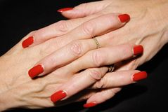 Waiting. Mature businesswoman with red fingernails Royalty Free Stock Image