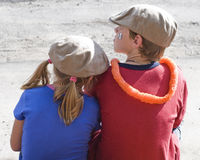 Waiting. Siblings wait for the parade to come down the small rural town's Main Street.  Photographed with a slight grain to give more of a old time look Stock Photography