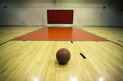 Waiting. Basketball quietly waiting for players in a gym in a small town in the US Royalty Free Stock Photos