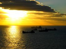Waiting. Cargo ships at sunset waiting in front of the harbour of Funchal / Madeira (Portugal Royalty Free Stock Photography