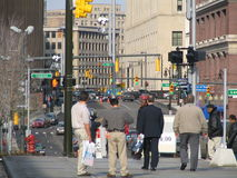 Waiting. A group of people waiting on the busy streets of Downtown Detroit Royalty Free Stock Photo