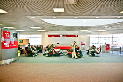 Waiting in the airport. A hall in an airport waiting area filled with people,Melbourne Airport,australia Royalty Free Stock Photo