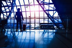 Waiting in the airport. Business man waiting in the airport royalty free stock photo