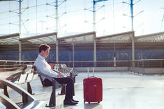 Waiting in the airport. Businessman waiting in the airport with laptop Stock Images