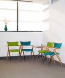 Waiting area. Pleasant waiting area with blue and green retro style chairs Stock Photos