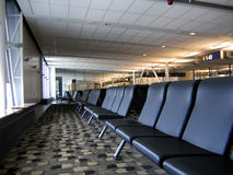 Waiting area at the airport. Rows of empty chairs at the waiting area at the airport Stock Images