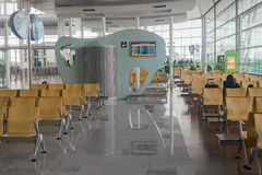 Waiting area at the airport with lonely passenger Stock Image