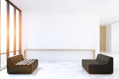 Waiting area with black sofas, toned Stock Photography