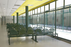 Waiting area with green chairs and windows. Royalty Free Stock Photography