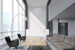 Waiting area in a white office Stock Images