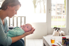 Waiting for baby's dinner. Happy young parent and a baby stock photo