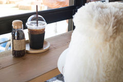 Waiting bear doll sit in the coffee shop Royalty Free Stock Image