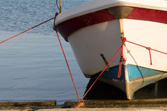 Waiting for better days. A colorful boat, fixed with cords at an harbor at the island of Sicilia, Italy Stock Photos