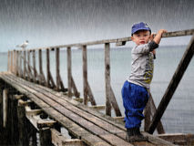 Waiting boy. Waiting child by the sea in heavy storm Stock Images