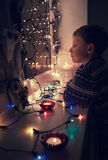 Waiting boy portrait in Christmas lights Stock Photo