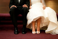 Waiting Bride and Groom. Sitting on a Church Pew Stock Image