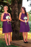 Waiting for the Bride. Two brides Maids standing waiting and looking for the Bride beside a large tree.  Shallow depth of field Stock Photography