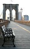 Waiting on the Bridge. Take a seat on Brooklyn Bridge royalty free stock photo