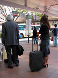 Waiting for the bus. People waiting for the bus in the station.All the insriptions are only bus traffic informations...no ads Stock Image
