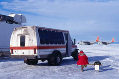 Waiting for a bus in Antarctica. Bus stop at the sea-ice runway that services the USAP station McMurdo.  Two LC-130 Hercules wait to fly to the South Pole Royalty Free Stock Photos