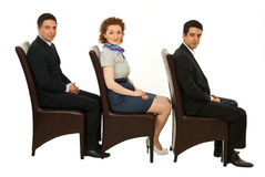 Waiting business people on chairs Royalty Free Stock Photography