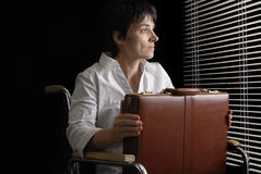 Waiting business woman in wheelchair Stock Images