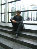 Waiting businessman. A man looking at his watch royalty free stock photos