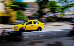 Waiting for a cab. Panning shot of a cab Stock Photography
