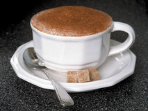Waiting cappucino. Hot cappucino with spoon and sugar cubes stock photos