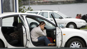 Waiting in car. A woman sitting inside a car, waiting in a ferry queue Royalty Free Stock Images