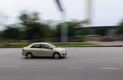 Waiting for a car passing by. Panning shot of a cab Stock Photography