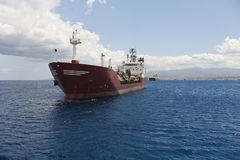 Waiting for Cargo. Group of cargo ships near Milazzo, Sicily Royalty Free Stock Photography