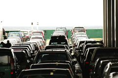 Waiting cars. Cars are parked on a ferry Royalty Free Stock Photo