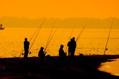 Waiting for the catch. 5 fishermen waiting Stock Images