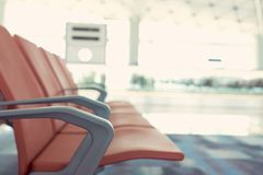 Waiting chairs of passengers in red airport. The background is the atmosphere in the airport. For passengers waiting to leave or m. Ay lie in the airport. with Royalty Free Stock Photography